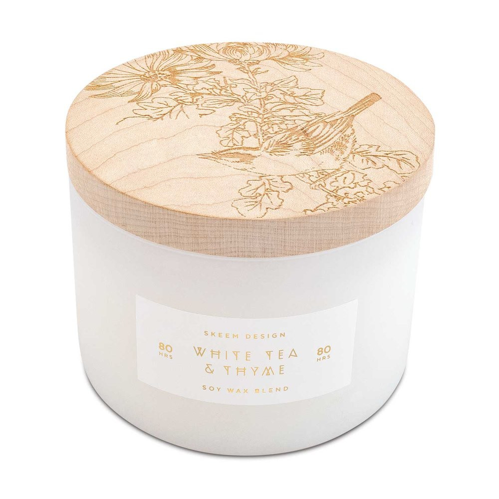 A candle that is as beautiful as it smells. These exquisite candles feature a bright white vessel and an intricately carved maple lid, filled with luxurious fragrances to fill your home!