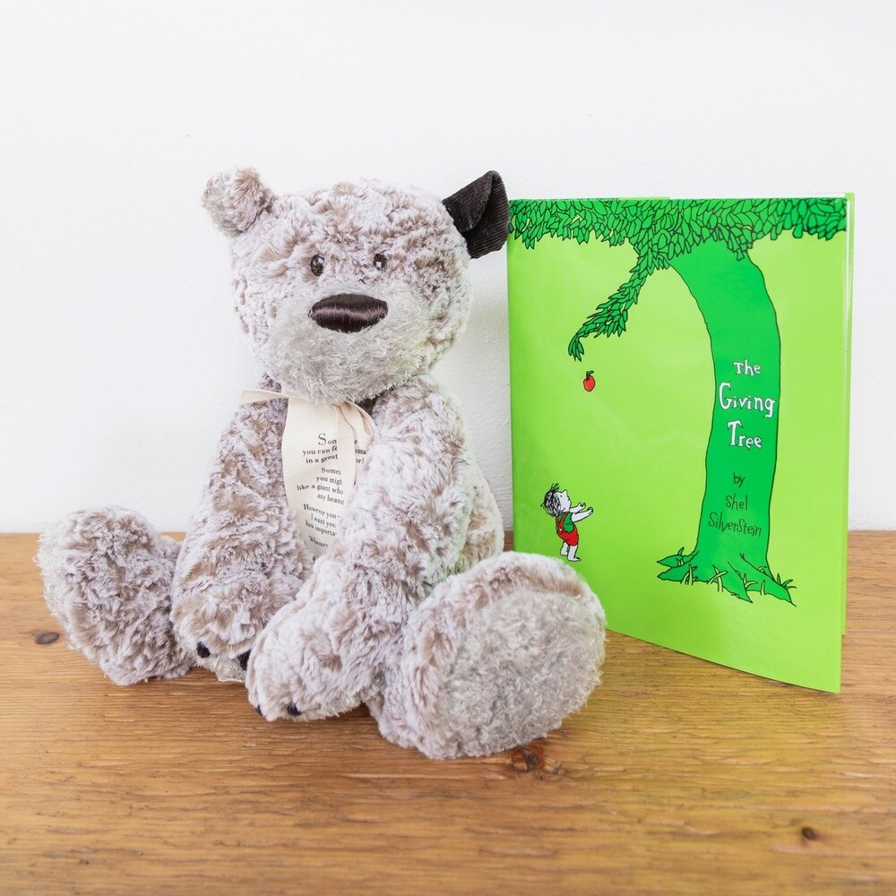 """The Giving Bear is a wonderful gift to remind someone while they may be down, they are never alone. The plush bear is the perfect cuddle buddy, and his corduroy  show's he's always listening. He includes a bookmark sharing his message, """"Sometimes you can feel so small in a great big world. Sometimes you might feel like a giant who can climb a beanstalk! However you are feeling, I want you to know how important YOU are. Whenever you need a little comfort, a little safe, a little brave, just whisper in my ear and hold me tight. I'll be here for you."""" The giving bear sits 12"""" tall and is 16"""" in total."""