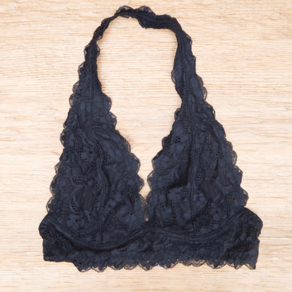 Stretchy and soft lace halter bralette with a plunging neckline, mesh lining and scalloped trim. Gives good support even without an underwire. Slip-on halter neck with a double hook-and-eye closure in back.