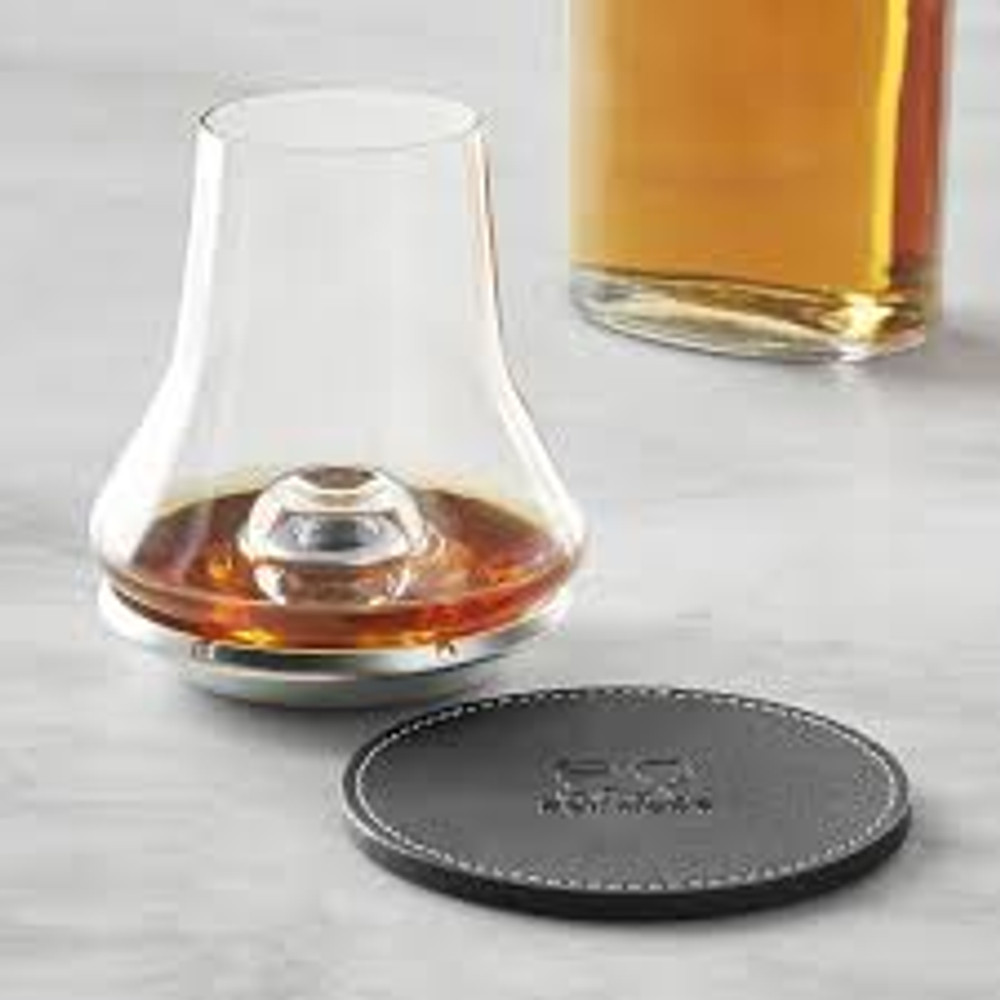 To create the perfect tasting experience, this set features a uniquely shaped glass, metal chilling base and leatherette coaster.