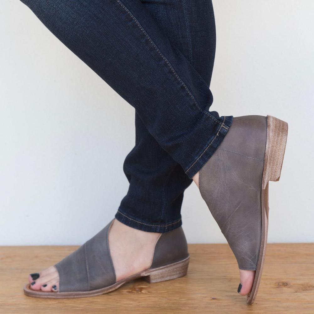 Dark Grey  Made with the finest Spanish craftsmanship and leather, this open toe shoe features side cutouts. Slight stacked heel. Fit: Runs true to size; if between sizes, size up.