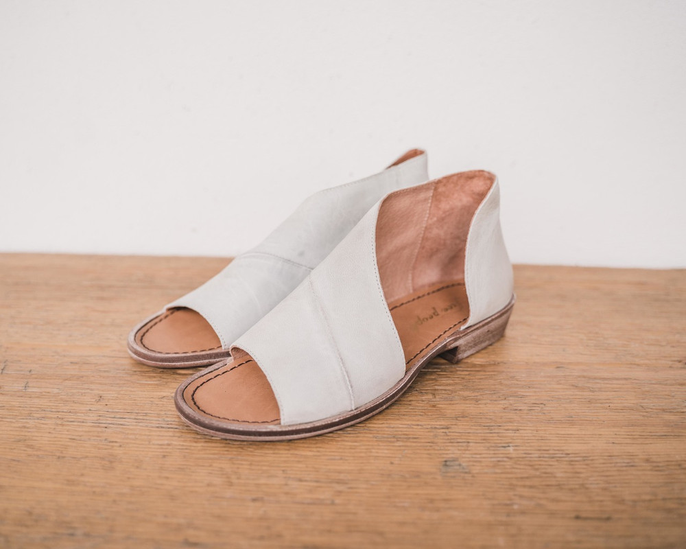 Dove Grey  Made with the finest Spanish craftsmanship and leather, this open toe shoe features side cutouts. Slight stacked heel. Fit: Runs true to size; if between sizes, size up.