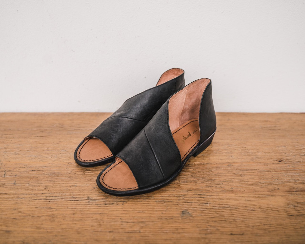 Black  Made with the finest Spanish craftsmanship and leather, this open toe shoe features side cutouts. Slight stacked heel. Fit: Runs true to size; if between sizes, size up.