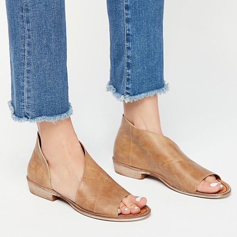 Brown  Made with the finest Spanish craftsmanship and leather, this open toe shoe features side cutouts. Slight stacked heel. Fit: Runs true to size; if between sizes, size up.