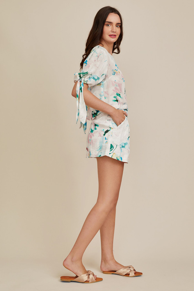 Heidi is an effortless silhouette that can be styled with the Christy Lynn Indigo shorts for a complete look. It features ties at the sleeves to create a puff shoulder or leave them loose for a more relaxed style.