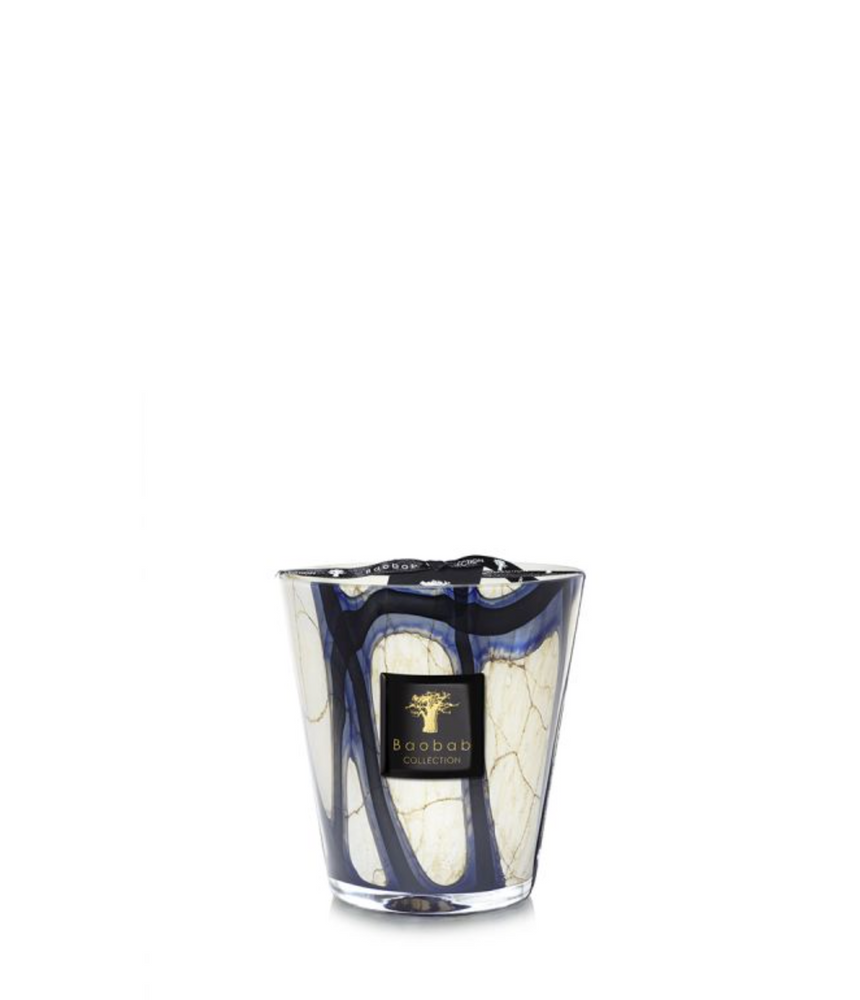 The hand-blown glass of the Stones Lazuli scented candle has a marbled pattern perfectly accented with vibrant blues.
