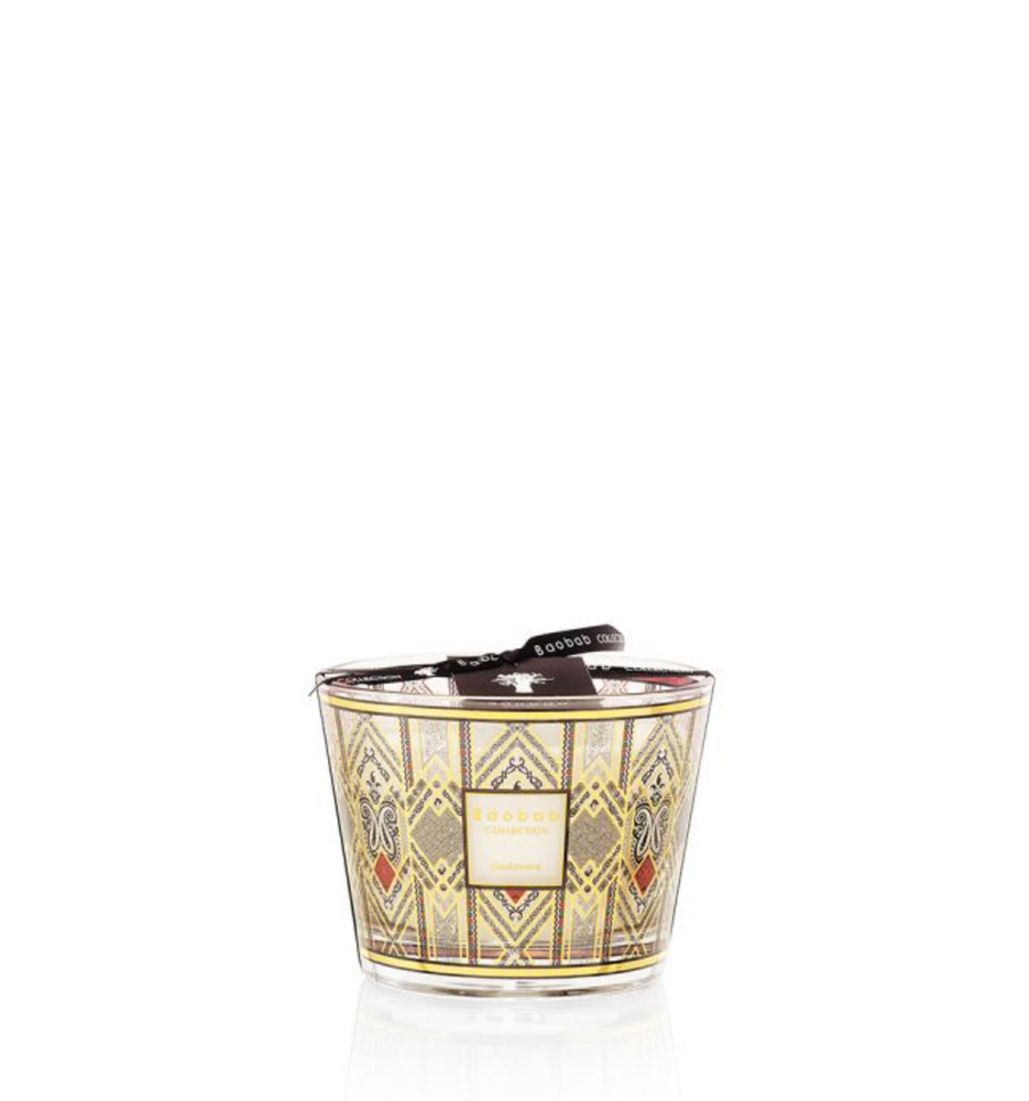 A nod to High Society the Cashmere scented candle is a 9-karat gold print applied to black glass.