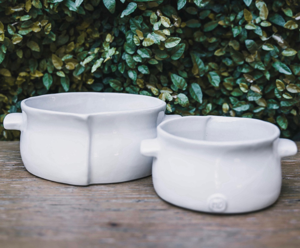 The perfect dish for cooking, serving, storing or just admiring! These bakers are handmade in Peru and high fired, creating a piece you can take from the fridge, to the oven, to the table, and drop it in the dishwasher when you're done! Created by Montes Doggett the white ceramic is a timeless piece with just enough organic feeling to make it special and unique.