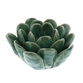Blue Our Succulent Tea Light Holders are true works of art. Each lovely, simple flower is hand-crafted; each petal is hand-formed. Then, each ceramic piece is given a hand-applied color glaze and a carefully crackled finish.