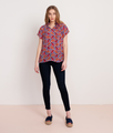 Phoenix Floral  This versatile blouse is the perfect addition to your already chic wardrobe. Slip this elegant number on for a day at the office, then reverse it for a night out on the town!