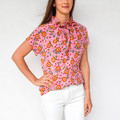 Pink Bloomberry  This versatile blouse is the perfect addition to your already chic wardrobe. Slip this elegant number on for a day at the office, then reverse it for a night out on the town!