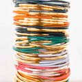 Top to Bottom: Navy/Gold, Orange/Gold, Navy/Gold, Green/Gold, Dust/Gold, Pink/Silver, Orange/Gold  A statement bracelet stack made easy! These skinny bangles feature brass beads on a leather bracelet available in a variety of colors.  Handmade in Seattle, Washington with environmentally friendly leather these bangles are a great to give to a girlfriend and yourself!