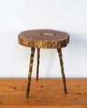 A unique piece that blends well with all styles. This chamcha and poured brass table has has just enough depth, shine, and intrigue to bring your space together.