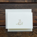 Karen Adams is known for their exquisite stationary, the Bunny Card is no different. Hand crafted artwork is full color printed on natural white paper and hand glittered in Memphis, TN.   Top fold card, blank on the inside, paired with a natural white envelope.