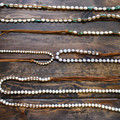 Tess Jewelry fresh water pearl necklaces hand wrapped in suede can be worn as a stacked choker, tied as a bolo or a combination of both.  This beautiful hand made necklace includes the small pearls.  Extremely comfortable, unique and stylish!