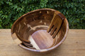 Enhance your table setting with this oversized acacia salad bowl. Featuring two contoured serving tools that sit flush inside the bowl it is sure to be a conversation starter.
