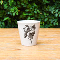 Magnolia  The perfect little. cup for every little thing. Fill it with your favorite beverage while dining, use it as a bathroom glass or as pot for your favorite little plant. This cup is sure to make you happy wherever it lives.   3.5"
