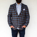 A sports jacket is a staple piece in every man's collection, together we set out to make ours better. The classic shape of this two button Sport Jacket Is updated with a bold plaid, it can easily be paired with a solid button down or matched with a patterned shirt for a modern style. The straight point button label accentuates the length of the torso while allowing the shirt collar to be opened or closed. The most exciting feature, the ultra light-weight fabric makes it the perfect year around piece for warmer climates. This Sport Jacket will be your new go to accessory to take you throughout the day and have you looking your best.