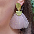 A statement earring that is as light as a feather! These Federika Padula earrings are made with natural, dyed and painted feathers to give a bold statement earring. The post earring sit comfortably in the lobe while the feather give a bold statement look and doesn't weigh down on the pierce hole.