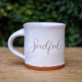 Enjoy your favorite beverage, hot or cold, in our signature Soulful Mug. Handmade by Tallahassee local artist, Julie Guyot.