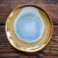 These ceramic plates are great as a coaster, spoon rest or even a ring dish! The reactive glaze gices each one a unique look and the gold electroplating is just the right amount of shine.