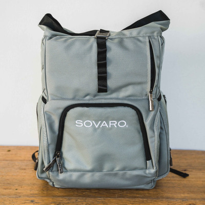 """You will never have to choose what to carry and what to leave behind with the Sovaro backpack cooler. You can stay active and arrive with chilled drinks!     18""""l X 7.5""""w X 21""""h   Capacity: 24 cans without ice container (2:1 ice ratio) - 6 bottles of wine without ice   Inner liner is food safe, removable ice container holds clean ice for making cocktails  Top fully opens for easy access to the entire cooler, stays close when you're on the move with a magnetic fold and hook closure  Large front pocket contains tethered bottle opener, two exterior pockets can easily hold your drinkware  Non-Marring bottom feet protect against wear and tear   3-year limited manufacturer's warranty"""
