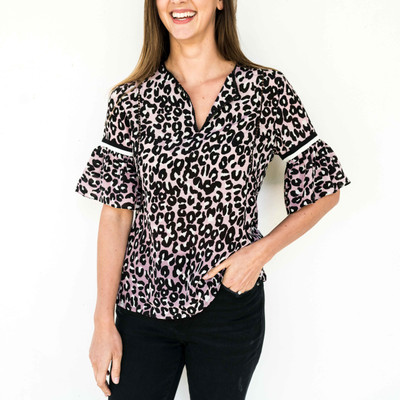 Every well-edited suitcase needs one of these blouses packed in it! We love the airy sleeves with contrast trim and the easy silhouette. Wear yours with jeans and a slide.
