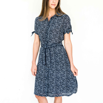 This dressier version of a summertime dress is perfect for any occasion or event. With it's fun tie accents and peter pan collar, you are sure to be one of the best dressed.