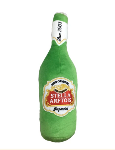 "Stella Arftois Beer Bottle Plush Toy - brand new from the Muttini Bar & Grill Collection where it is ALWAYS Happy Hour! Your pampered pooch deserves their own bottle of ""impawted"" Stella Arftois Beer.  Stella Arftois Beer Bottle Plush Toy is available in one size only.  Stella Arftois Beer Bottle measures 8 inches.  Imported."