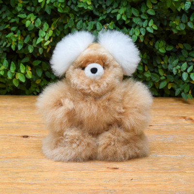 Handmade with 100% Baby Alpaca fibers this is one of the softest bears around! Available in assorted colors, please specify preference in order notes.