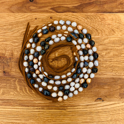 Hand made by Karen Daniels of Tess Jewelry design this fresh water pearl creation is one of a kind.  Wrapped with suede the pearl necklace can be worn a multitude of ways to compliment any outfit.