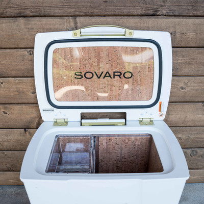 "Stylish, functional, and on wheels! What more could you need in a cooler? Sovaro has checked all the boxes and more with their hard-sided coolers.   THE DETAILS - Modern, clean lines give this cooler an elevated simple style while offering uncompromised performance.   - The exterior height is sized to provide comfortable seating, while the extra height inside gives you room to store wine or spirit bottles upright.   - Cast side handles for easy lifting, telescoping extension handle for easy pulling, and heavy-duty wheels for easy rolling.    - Friction hinges make for easy close and an open hold while the one-touch latch ensure a tight seal.  - The transparent interior liner is scratch resistant, easy to clean and the reservoir holds extra liquids while the rear plug allows for easy drainage.   - The cork is not just a pretty feature, it is a natural insulator, impermeable to gas and liquid and doesn't attract mold or mildew.   - Each cooler includes a removable divider for easy organization.     30 qt cooler  - Capacity: 8 standing wine bottles   - 16 5/8""l X 23 1/9""w X 17 3/4""h   45 qt cooler  - Capacity: 10 standing wine bottles"
