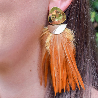 Rooster Saddle Caramel Brown  A statement earring that is as light as a feather! These Federika Padula earrings are made with natural and dyed feathers to give a bold statement earring. The post earring sit comfortably in the lobe while the feather give a bold statement look and doesn't weigh down on the pierce hole.