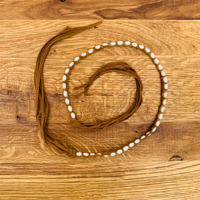 Tess Jewelry fresh water pearl necklaces hand wrapped in suede can be worn as a stacked choker, tied as a bolo or a combination of both.  Extremely comfortable, unique and stylish!