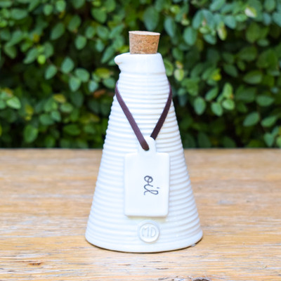 For the oil you'll never want to put away. This cruet is perfectly accented by the cork top and leather sash holding the 'oil' tag. Great for serving, your counter, and just to enjoy!