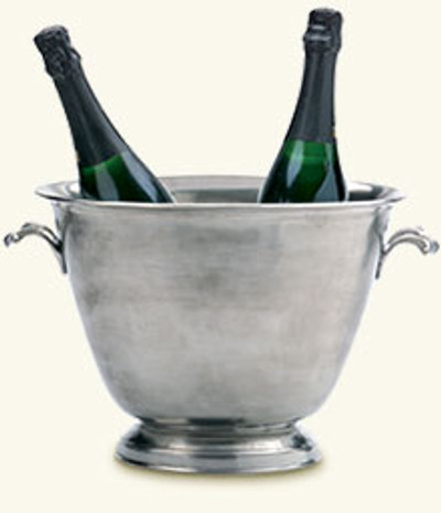 "Hand-crafted in Italy and containing 95% tin, Match produces a line of modern heirlooms that are sure to be enjoyed for generations.      Chill two bottles of wine in style, arrange your seasonal flowers, or allow this piece to hold centerstage all by itself. The double champagne bucket will be your statement piece for every occasion. 13""w X 9.5""h"