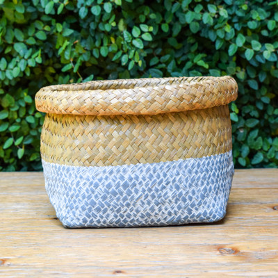 Hand-made by artisans in Vietnam this basket is a beautiful way to keep your life organized. It's woven, folded, and painted by hand to create a perfectly neutral piece with a soft blue gray painted bottom. Perfect for mail, fruit, toys, or anything else that can never seem to find a home.