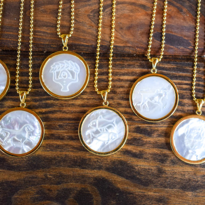"The perfect amount of sophistication and classic design combined with your sun sign. These 1.25"" mother of pearl Zodiac Pendants offer the right amount of understated glam. They are surrounded by a gold vermeil casing, and come on a beaded chain.     1.25"" diameter   Sold with beaded chain  MOP and 14k vermeil"