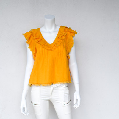 It's like wearing summertime, the Yosepha Top is 100% soft linen with pintucks and a free and easy vibe. The raw edged ruffles add a little bit of femme to this fun and flirty top.