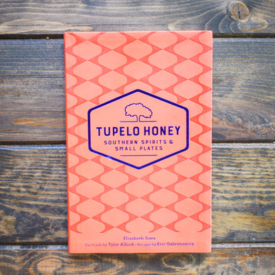 In Tupelo Honey's latest cookbook, 70 unique cocktail and 30 delicious small plate recipes are organized around popular themes, such as Friendly Competition, The Roots of Southern Music, Southern Festivals, Southern Drinking Celebrations, Iconic Southern Food and Drink, and Simple, Everyday Life. Some of the playful cocktail names in this book may give you pause, but once you try them, your taste buds will smile.