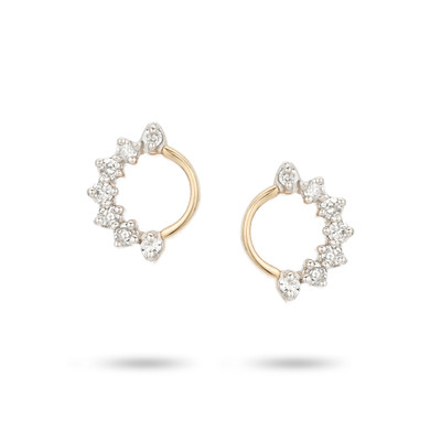 An effortlessly classic pair of earrings you can wear all day, everyday. The diamonds are scattered along the outside of the circle posts creating a whimsical take on classic diamond earrings.