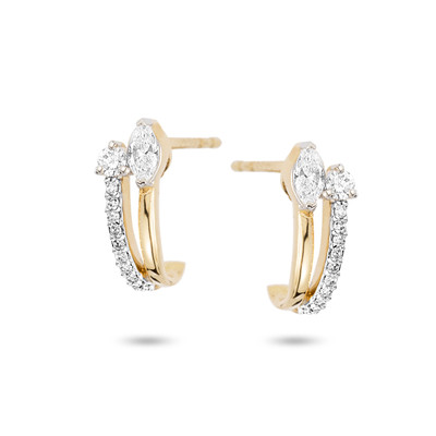 A modern interpretation of the classic huggie hoop. The Grace Marquise + Round J Hoop Earrings offer two diamonds and hand set pave diamonds down the side all set in 14k yellow gold.