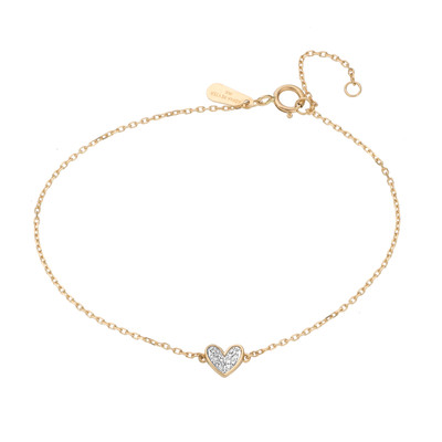 Adina Reyter's signature folded heart has made its way to a delicate everyday bracelet, you'll never want to take off. The 14k yellow gold is accented with a folded heart filled with hand set pave diamonds to create a dainty piece to wear alone or stack with others.