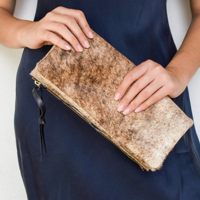 A great clutch for your everyday essentials. The natural hair on hide gives a neutral texture that you can pair back with any ensemble!