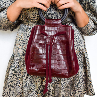 Incredibly chic, the Carmella Drawstring bag is the perfect accessory for any outfit. Large enough to fit the daily necessities and petite enough to accompany to any dinner or event! The drawstrings give you thee added assurance of never having a spill!