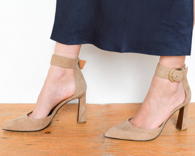 You'll want to walk a mile in these shoes! The exaggerated buckle gives you that little bit of glam and the perfect shade of nude they will be your go-to for every event!