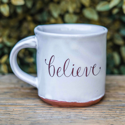 Enjoy your favorite beverage, hot or cold, in our signature Believe Mug. Handmade by local Tallahassee artist, Julie Guyot.