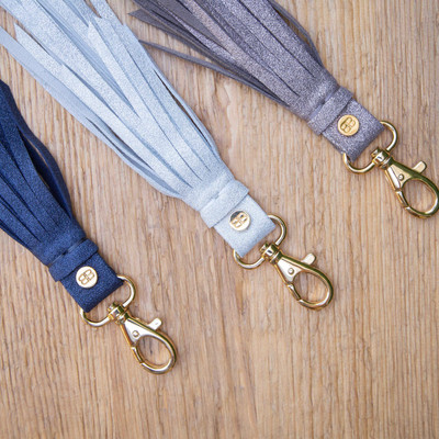 Our B-Low The Belt tassel key chains add the perfect touch of glam to your set of keys!