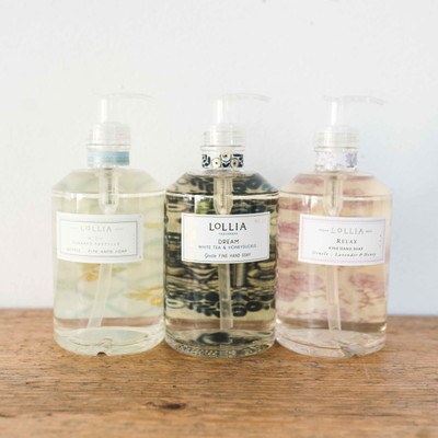 Cleanse & Condition. This gentle hand soap formula is rich in botanicals and infused with Lollia's signature fragrance blends for a fragrant, silky clean. Hydrating Honey & Aloe refresh hands and restore radiance while Lavender extracts soothe & condition, leaving skin silky soft. Divinely-scented suds sure to delight you and your guests. A lovely sink-side addition, this sophisticated glass bottle is complete with a hand pump and elegantly tailored label.
