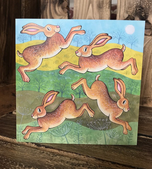 Leaping Hares Greeting Card